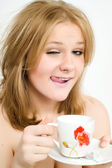 Young woman with a cup of hot drink — Stock Photo