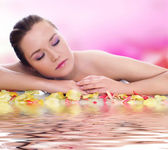 Beautiful young blond is in the petals — Stock Photo