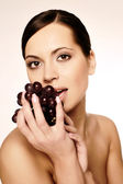 Beautiful young woman with grape — Stock Photo