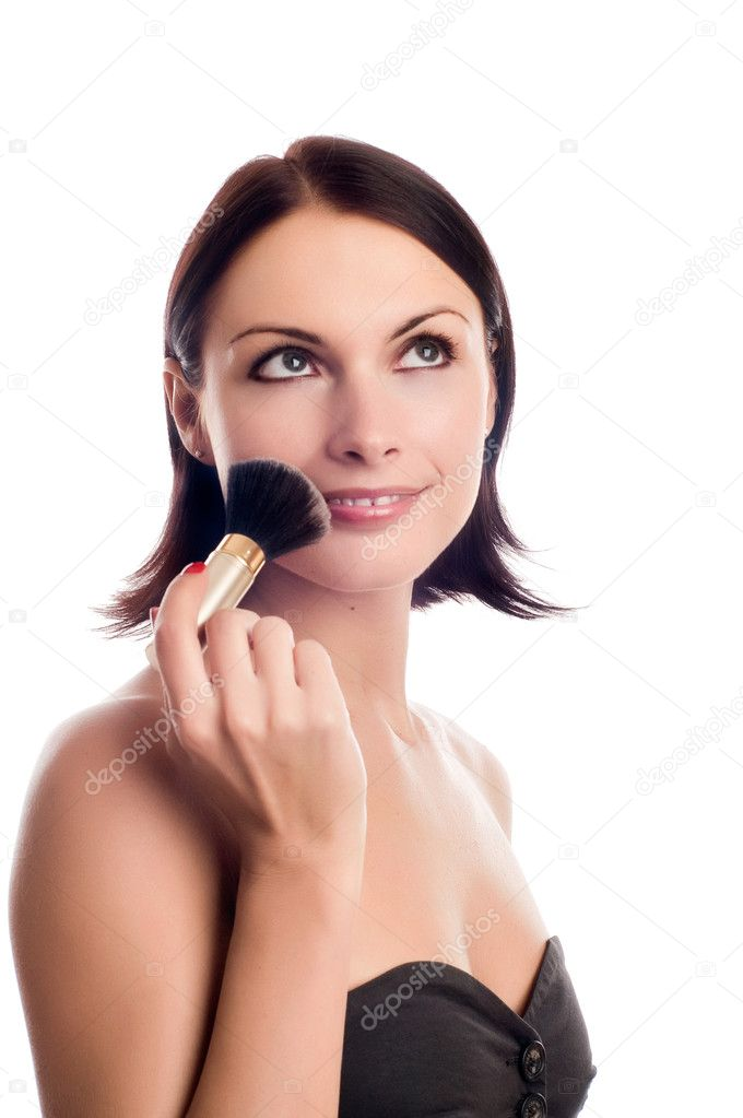 Portrait of attractive young adult woman applying blusher  Stock Photo #1014743