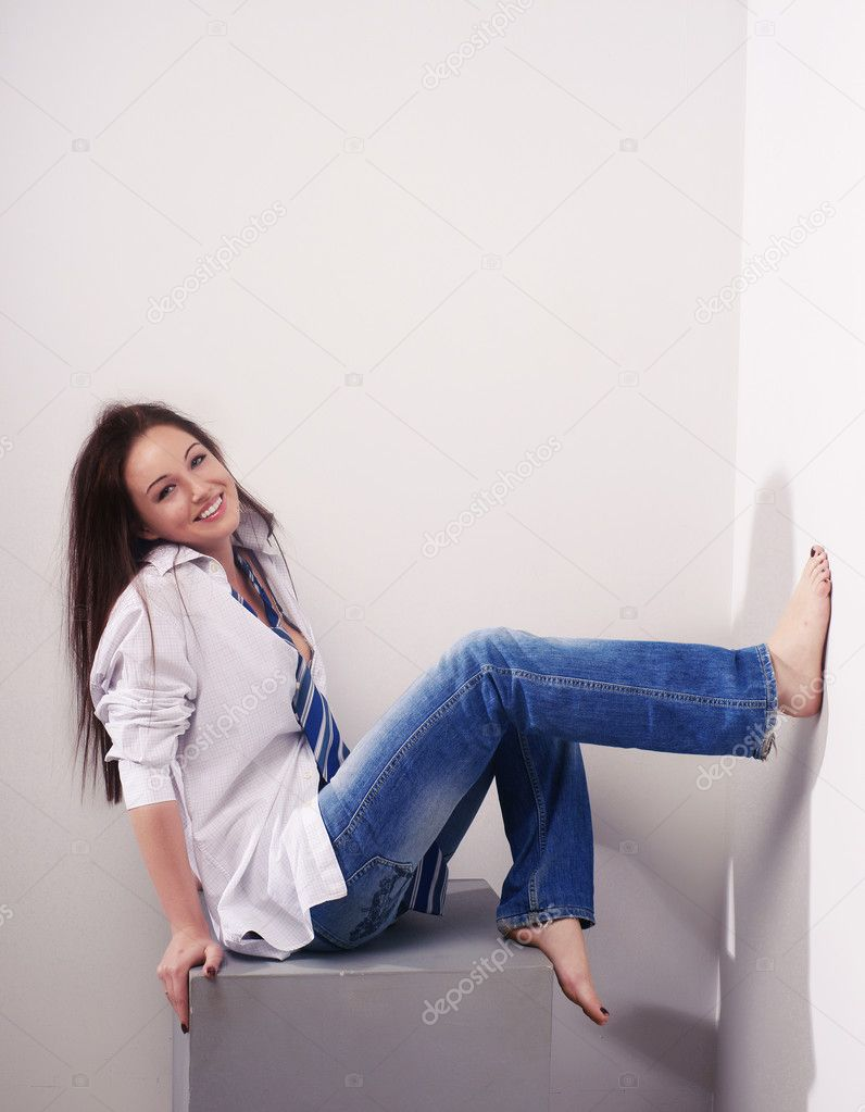Beautiful girl in blue jeans — Stock Photo © thandra #1017144