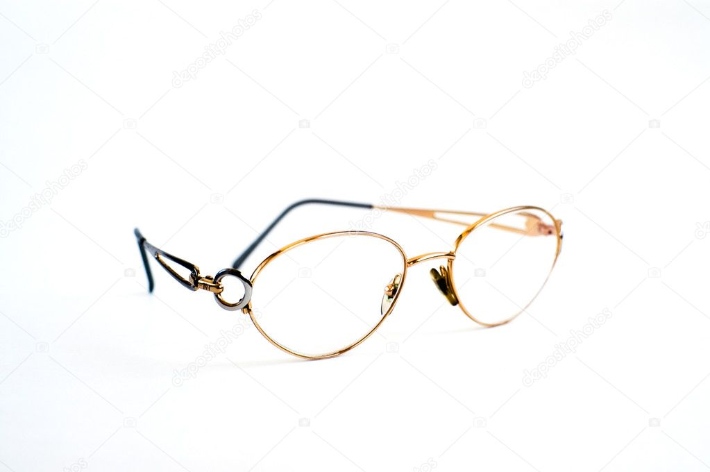 Eyeglasses in a gold frame on a white background — Stock Photo #1017441