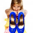 Young blonde with blue shoes — Stock Photo #1020072