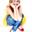 A young beautiful blonde is sitting — Stock Photo