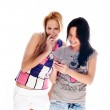 Young beautiful women using the cellphon — Stock Photo