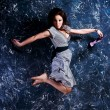 Beautiful young woman in a jump — Stock Photo