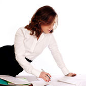 Businesswoman writing documents — Stock Photo