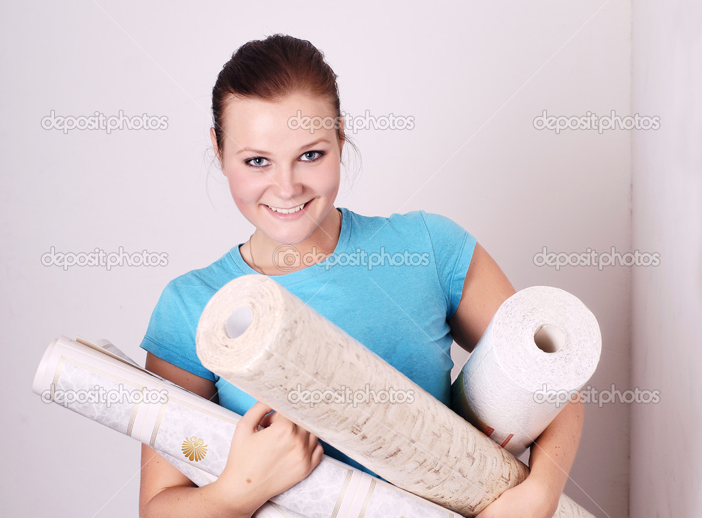 Beautiful young woman with the wallpaper in the hands of  Stock Photo #1637576