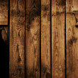 Royalty-Free Stock Photo: Old brown wood fence with a hole