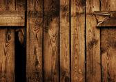 Oud bruin houten hek met een gat — Stockfoto