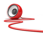 Red speaker with cable over white — Stock Photo