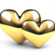 Stockfoto: Two gold hearts on white background