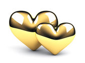 Two gold hearts on the white background — Stock Photo