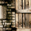 Stock Photo: Old grungy brick and wooden texture