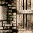 Old grungy brick and wooden texture — Stock Photo