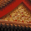 Stock Photo: Ornate chinese roof of temple