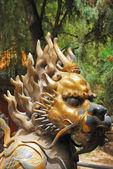 Bronze lion in Forbidden City garden — Stock Photo