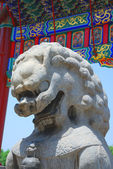 Bronze lion in Forbidden City garden — Stock Photo