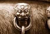 Ancient bronze lions as a handle of vat — Stock Photo