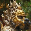 Bronze lion in Forbidden City garden — Stock Photo #1011103