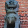 Stone lion near Forbidden city — Stock Photo
