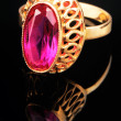 Golden ring with pink gem — Stock Photo #1010326