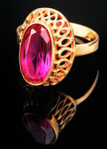 Golden ring with pink gem — Stock Photo