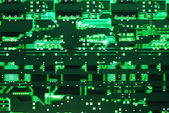 Back lighted green circuit board — Stock Photo