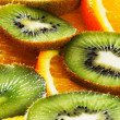 Orange and kiwi background — Stock Photo