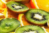 Orange and kiwi background — Stock Photo