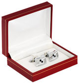 Silver cuff links in red box — Stock Photo