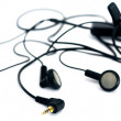 Audio earphones over white — Stock Photo