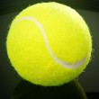 Royalty-Free Stock Photo: Tennis ball over black background