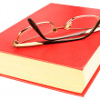 Stock Photo: Red book and glasses