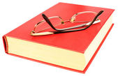 Red book and glasses — Stock Photo