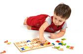 Chłopiec i alfabet — Zdjęcie stockowe