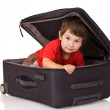Stock Photo: Little boy inside suitcase