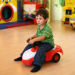 Little boy driving a toy car — Stock Photo