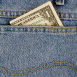 Royalty-Free Stock Photo: One dollar in a jeans pocket