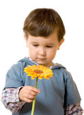 Boy holds a yellow flower — Stock Photo