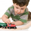 Boy playing with a train set — Foto de Stock