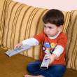 Boy with remote controls — Stock Photo