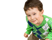Smiling little boy with sly eyes — Stock Photo