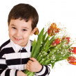 Royalty-Free Stock Photo: Boy with bouquet of red-yellow tulips