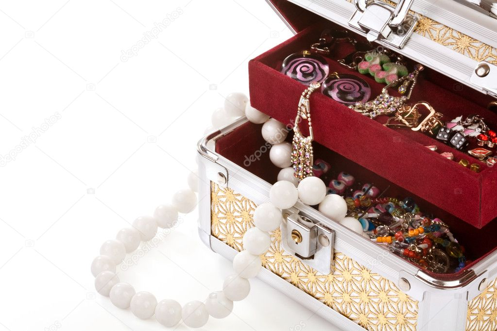Opened casket filled with costume jewellery — Stock Photo #2499530