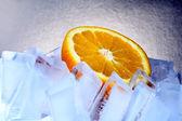 Orange and ice — Stock Photo