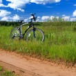 Bicycle in summer landscape — Stock Photo
