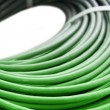 Stock Photo: Hank of a green network cable