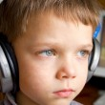 Little boy in ear-phones — Stock Photo #1025352