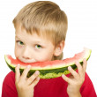 Boy eating a piece of watermelon — Stock Photo #1027549